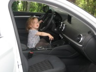 Nora loved trying to drive and was very good at pushing all the buttons.