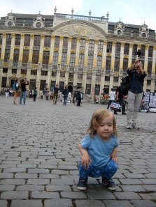 Nora 'squating' in the Grand Place Brussels- probably the city we could have skipped.