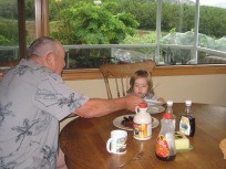 Showing Great Grandpa how many roll-up pancakes a 2 year old can eat.