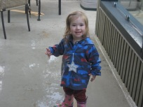 Shahid made the deck wet so that a very happy Nora could try out her new rain boots.