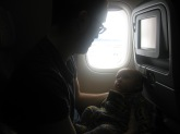 Max and Dad on the flight back to Spain.
