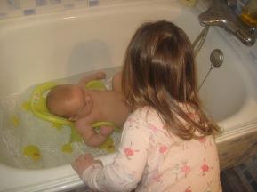 Nora giving Max a bath.
