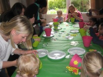 Decorating plant pots to put our eggs in.