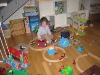 Nora loving the train sets.