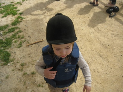 Helmet on- but only needed for a moment as the pony had a wobbly back and Nora prefers non wobbly backs.