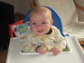 Max trying out the highchair.