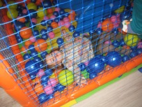 Nora almost fell asleep in the ball pit.