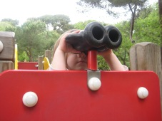 Nora was using the binocular's to check out a jungle.
