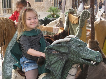 So psyched to ride a dragon while wearing a dragon cape.