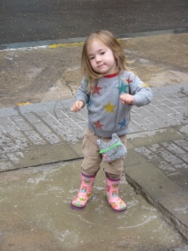 Dancing for joy in a rain puddle.